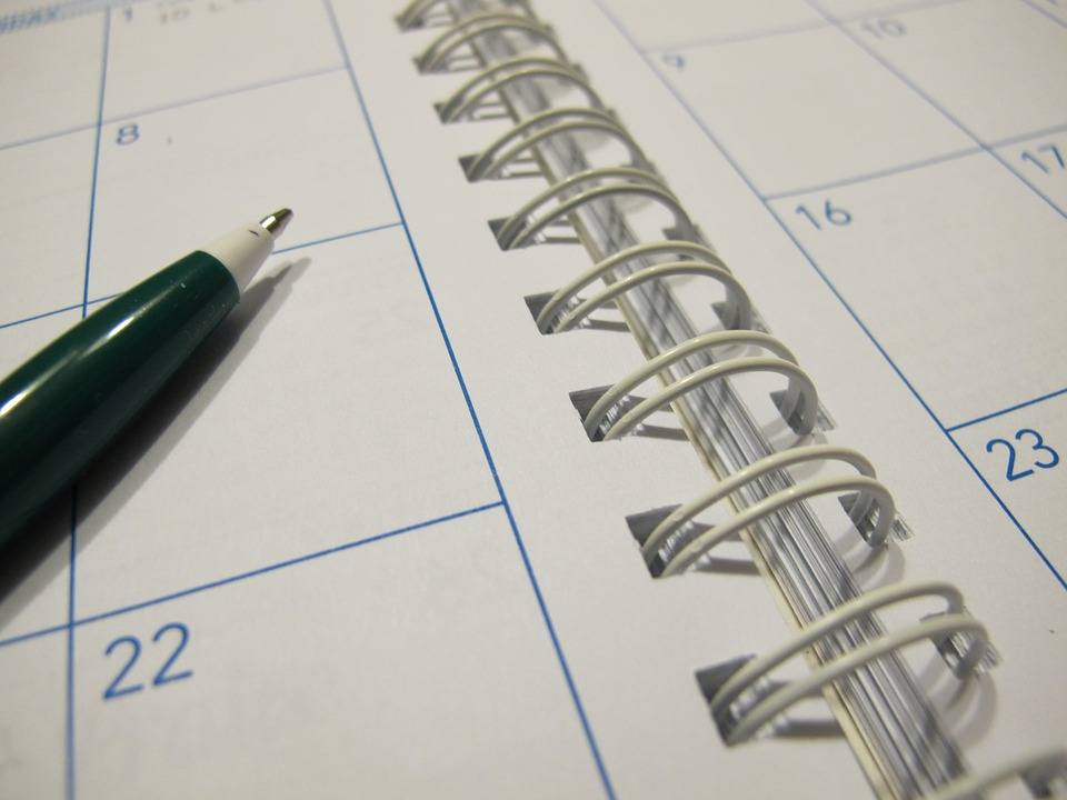 image of pen and diary to organise